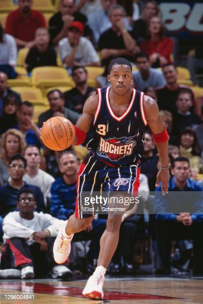 Steve Francis, Point Guard and Shooting Guard for the Houston Rockets dribbles the basketball during the NBA Pacific Division basketball game against...