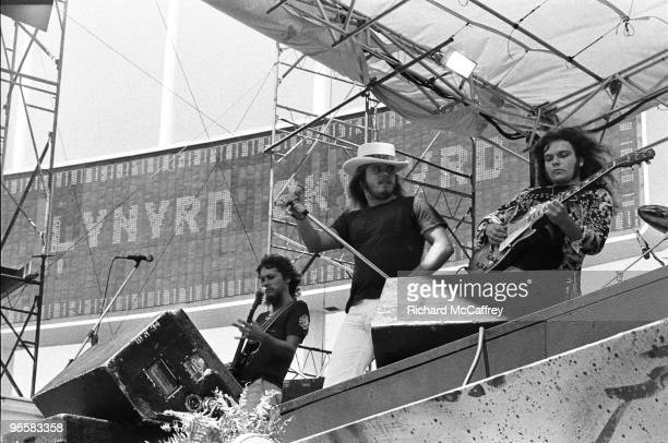 R Steve Gaines Ronnie Van Zant and Gary Rossington of Lynyrd Skynyrd perform live at The Oakland Coliseum in 1976 in Oakland California