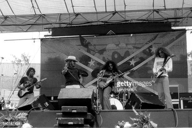 Steve Gaines Ronnie Van Zant Gary Rossington and Allen Collins are performing with ' Lynyrd Skynyrd' at the Day on the Green at the Oakland Coliseum...