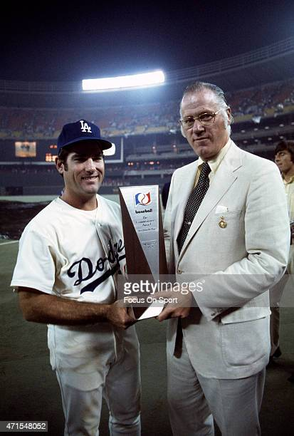 Steve Garvey of the Los Angeles Dodgers and the National League AllStars is presented with the Most Valuable Player Award by Commissioner Bowie Kuhn...