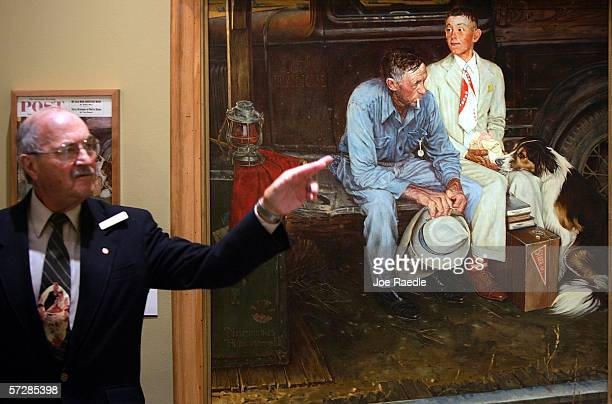 Steve Gershoff a museum guide speaks to visitors next to the copy of Norman Rockwell's painting titled Breaking Home Ties which has been hanging on...