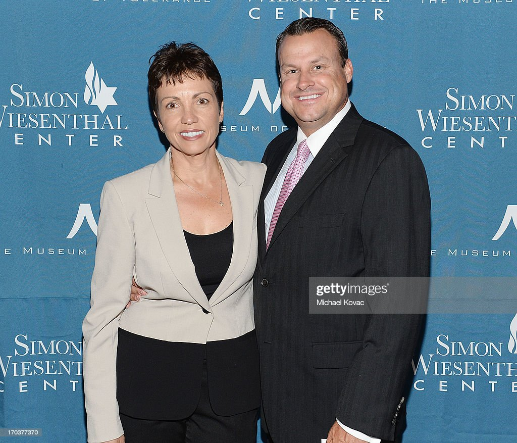 Steve Ghysels (R) and Liz Ghysels arrive at the Simon Wiesenthal Center National Tribute Dinner at Regent Beverly Wilshire Hotel on June 11, 2013 in Beverly Hills, California.