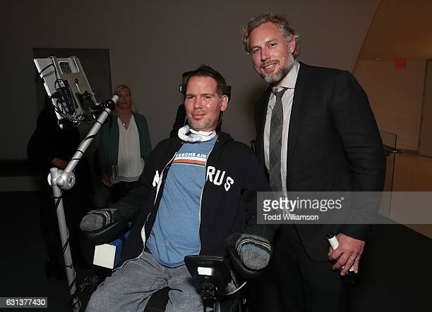 Steve Gleason and Eric Johnson attend a Cocktail Reception to Celebrate GLEASON on January 9 2017 in Los Angeles California