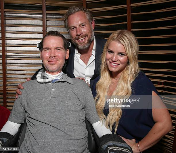 Steve Gleason Eric Johnson and Jessica Simpson attend the Gleason Los Angeles Premiere at Regal Cinemas LA Live on July 14 2016 in Los Angeles...