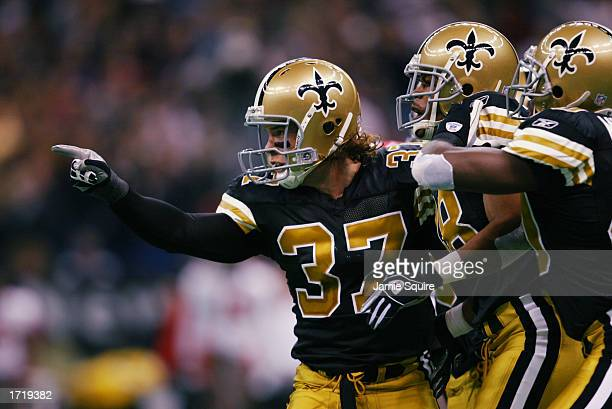 Steve Gleason of the New Orleans Saints celebrates a tackle against the Tampa Bay Buccanneers during the first half of the game on December 1 2002 at...
