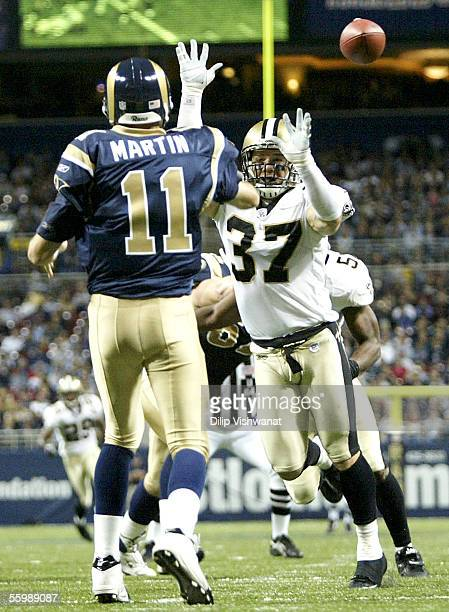 Steve Gleason of the New Orleans Saints pressures Jamie Martin of the St Louis Rams at the Edward Jones Dome on October 23 2005 in St Louis Missouri...