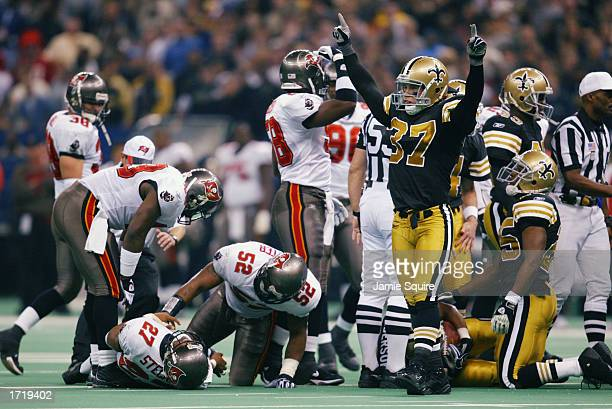 Steve Gleason of the New Orleans Saints signals possession after the Saints recovered a fumble from Aaron Stecker of the Tampa Bay Buccanneers during...