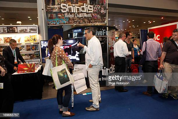 Steve Gottlieb, founder & CEO, Shindig speaks with guest at Shindig Hosts Live Video Chats with over Fifty Authors at BookExpo America 2013 at Jacob...