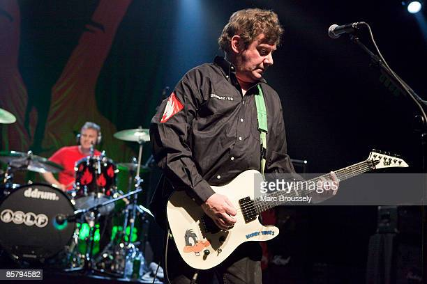 Steve Grantley and Jake Burns of Stiff Little Fingers perform at the Forum on April 3 2009 in London England
