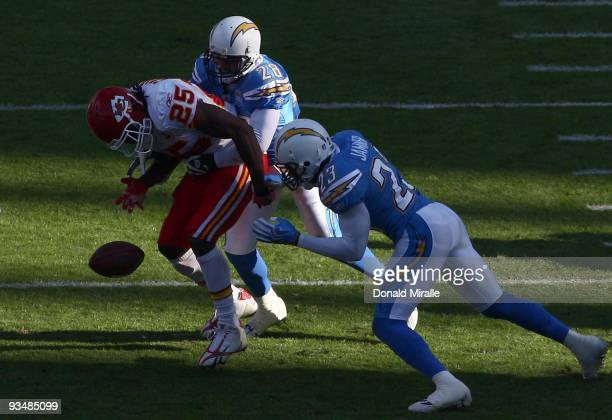 Steve Gregory and Quentin Jammer of the San Diego Chargers forces a fumble by Runningback Jamaal Charles of the Kansas City Chiefs during the NFL...