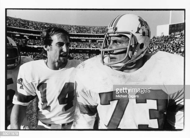 Steve Grogan of the New England Patriots congratulates teammate John Hannah following a score during the 1976 AFC Divisional Playoff game against the...