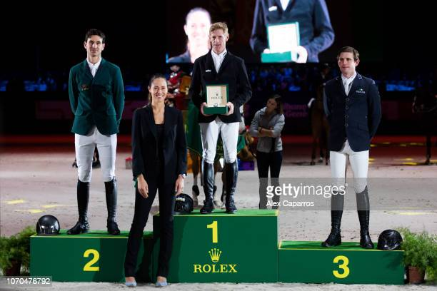 Steve Guerdat of Switzerland in 2nd place Marcus Ehning of Germany in 1st place and Darragh Kenny of Ireland in 3rd place pose with Rolex Testimonee...