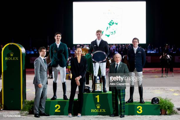 Steve Guerdat of Switzerland in 2nd place Marcus Ehning of Germany in 1st place and Darragh Kenny of Ireland in 3rd place pose in the podium with...