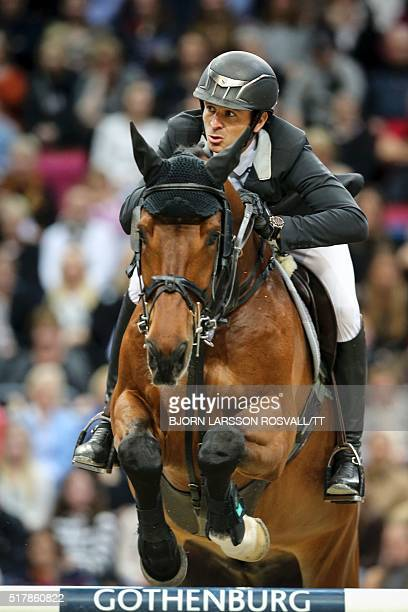 Steve Guerdat of Switzerland rides his horse Corbinian during the Longines FEI World Cup Jumping Final III event of the Gothenburg Horse Show at...
