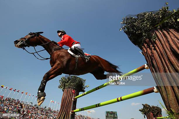 Steve Guerdat of Switzerland riding Nino Des Buissonnets competes during the Equestrian Jumping Individual Final Round on Day 14 of the Rio 2016...