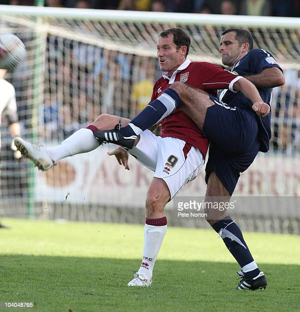 Steve Guinan of Northampton Town attempts to control the ball under pressure from Chris Barker of Southend United during the npower League Two match...