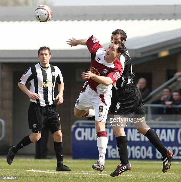 Steve Guinan of Northampton Town contests the ball with Mike Edwards of Notts County during the Coca Cola League Two Match between Northampton Town...