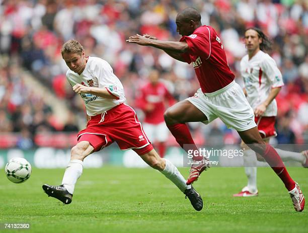 Steve Guppy of Stevenage Borough takes on Michael Blackwood of Kidderminster Harriers during the FA Trophy Final match between Kidderminster Harriers...