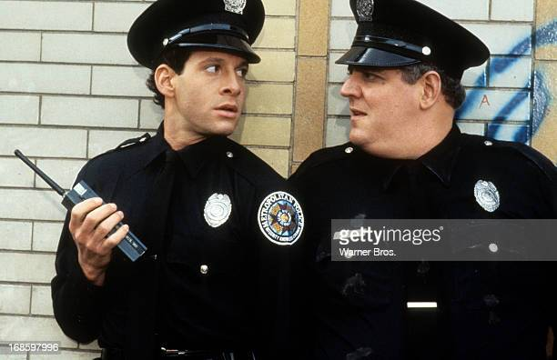 Steve Guttenberg looks to another cop in a scene from the film 'Police Academy 2 Their First Assignment' 1985