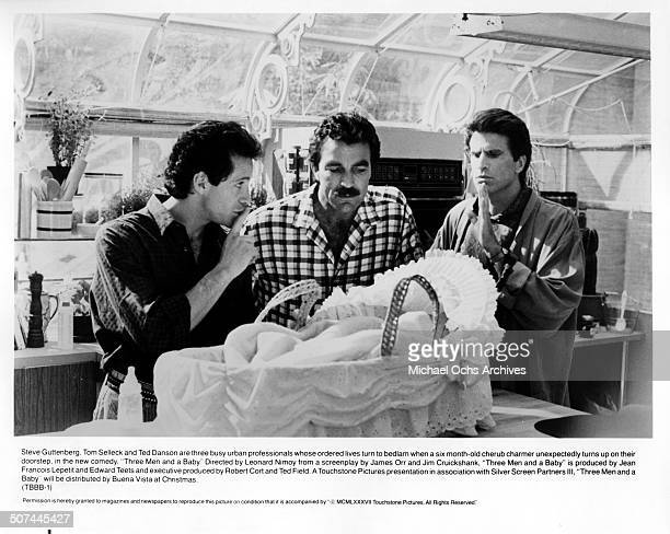 Steve Guttenberg Tom Selleck and Ted Danson keep quiet as the baby sleeps in a scene from the movie 3 Men and a Baby circa 1987