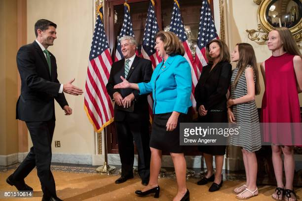 Steve Handel looks on Speaker of the House Paul Ryan arrives and shakes hands with Representativeelect Karen Handle before a ceremonial swearingin on...