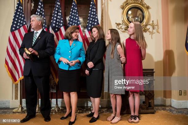 Steve Handel Representativeelect Karen Handle and family await Speaker of the House Paul Ryan before a ceremonial swearingin on Capitol Hill June 26...