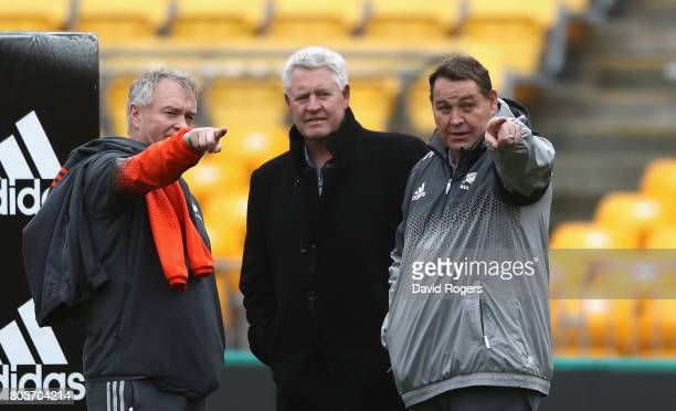 Steve Hansen the All Black head coach talks to NZR CEO Steve Tew and All Black selector Grant Fox during the New Zealand All Blacks Captain's Run at...