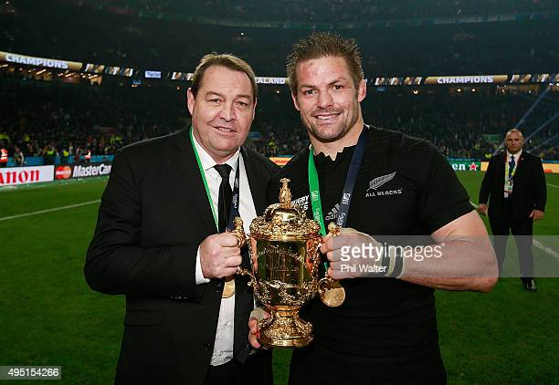 Steve Hansen the head coach of New Zealand and Richie McCaw of New Zealand pose with the Webb Ellis Cup after victory in the 2015 Rugby World Cup...