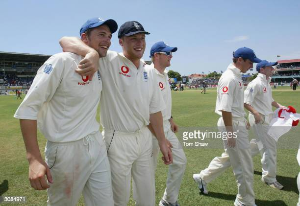 Steve Harmison and Andrew Flintoff of England celebrate on a lap of honour after winning the test match during Day 4 of the 1st Test between West...
