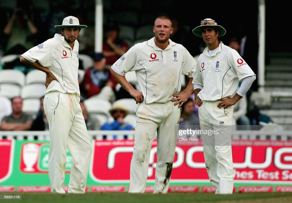 Steve Harmison, Andrew Flintoff and Michael Vaughan of England look on as they wait for a decision for bad light during day three of the fifth npower Ashes Test match between England and Australia at the Brit Oval on September 10, 2005 in London, England.