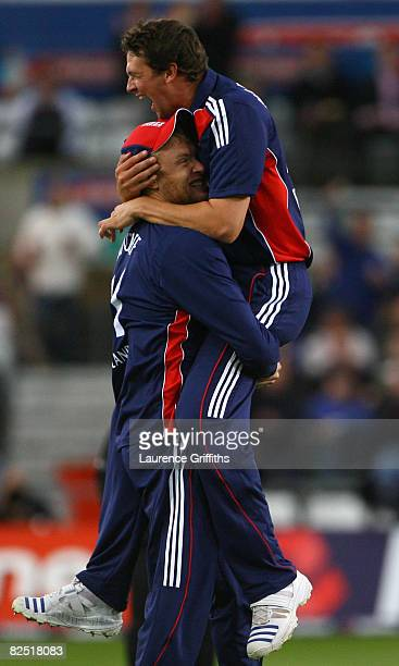 Steve Harmison of England celebrates with team mate Andrew Flintoff after taking the wicket of Graeme Smith of South Africa during the First NatWest...
