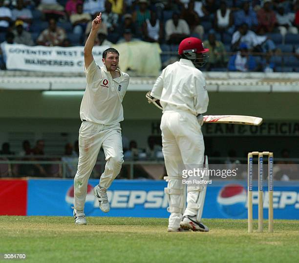 Steve Harmison of England takes the wicket of Fidel Edwards during the Cable and Wireless 1st Test match between West Indies and England at the...