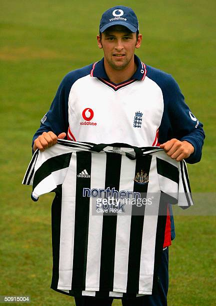 Steve Harmison poses with a Newcastle United shirt after a nets session prior to the 2nd NPower Test match at Headingley cricket ground on June 1 in...