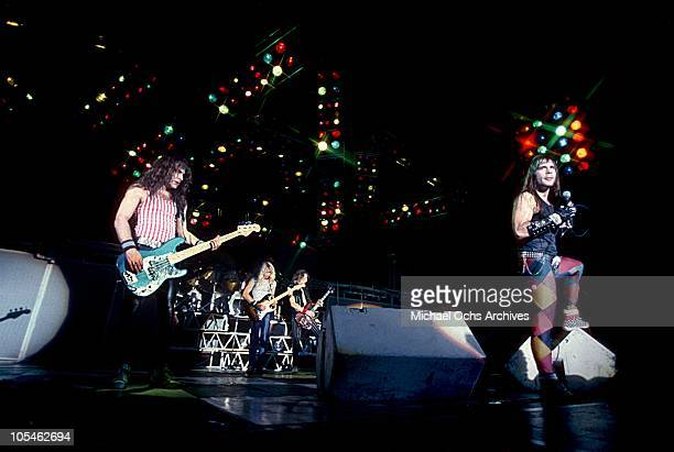 Steve Harris Nicko McBrain Dave Murray Adrian Smith and Bruce Dickinson of the heavy metal band 'Iron Maiden' perform onstage in September 1983