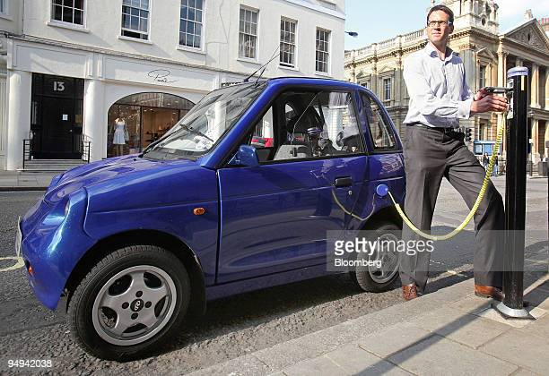 Steve Hartridge plugs his GWiz electric car into a roadside charger in central London UK on Monday April 20 2009 The UK government will offer buyers...