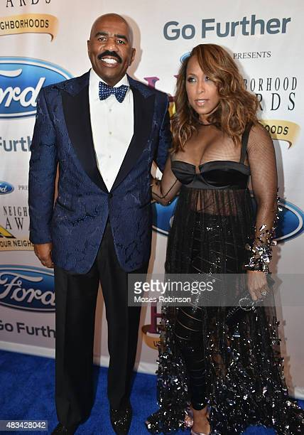Steve Harvey and Marjorie Harvey attend the 2015 Ford Neighborhood Awards Hosted By Steve Harvey at Phillips Arena on August 8 2015 in Atlanta Georgia