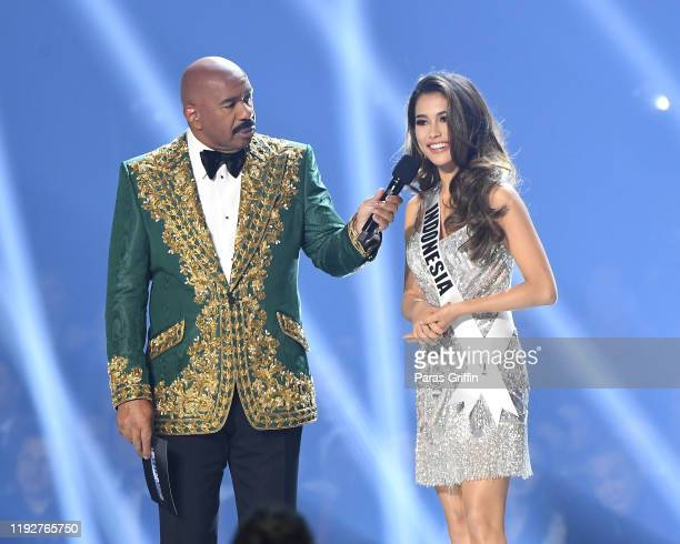 Steve Harvey and Miss Indonesia Frederika Cull speak onstage at the 2019 Miss Universe Pageant at Tyler Perry Studios on December 08 2019 in Atlanta...