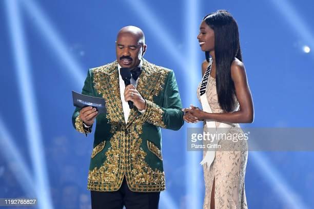 Steve Harvey and Miss Nigeria Olutosin Araromi speak onstage at the 2019 Miss Universe Pageant at Tyler Perry Studios on December 08 2019 in Atlanta...
