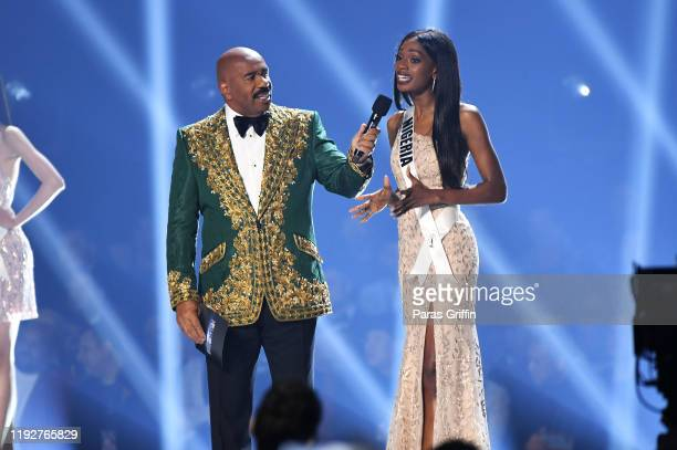 Steve Harvey and Miss Nigeria Olutosin Araromi speak onstage at the 2019 Miss Universe Pageant at Tyler Perry Studios on December 08 2019 in Atlanta...