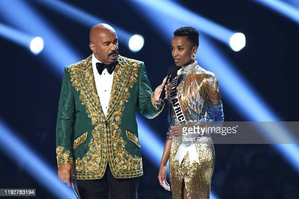 Steve Harvey and Miss South Africa Zozibini Tunzi speak onstage at the 2019 Miss Universe Pageant at Tyler Perry Studios on December 08 2019 in...