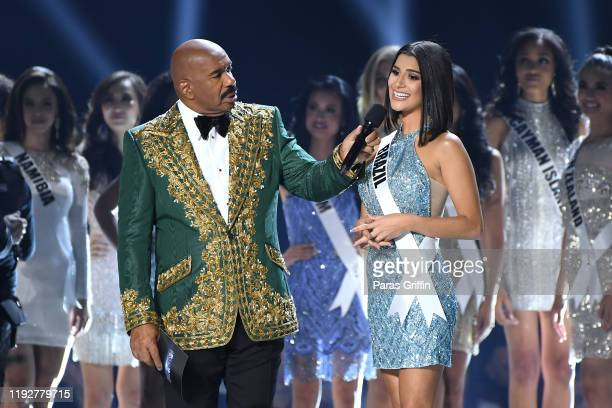 Steve Harvey interviews Miss Brazil Julia Horta onstage at the 2019 Miss Universe Pageant at Tyler Perry Studios on December 08 2019 in Atlanta...