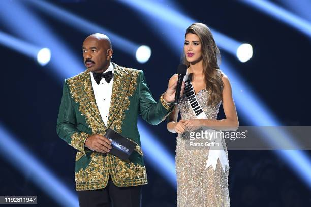 Steve Harvey interviews Miss Colombia Gabriela Tafur Nader onstage at the 2019 Miss Universe Pageant at Tyler Perry Studios on December 08 2019 in...
