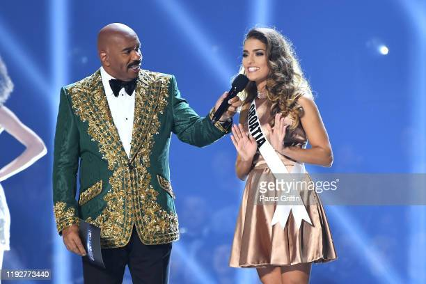 Steve Harvey interviews Miss Croatia Mia Rkman onstage at the 2019 Miss Universe Pageant at Tyler Perry Studios on December 08 2019 in Atlanta Georgia
