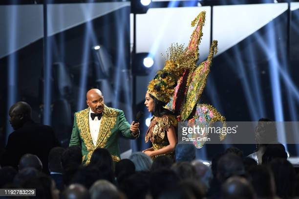 Steve Harvey interviews Miss Malaysia Shweta Sekhon at the 2019 Miss Universe Pageant at Tyler Perry Studios on December 08 2019 in Atlanta Georgia