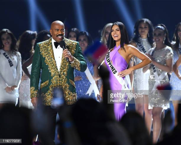 Steve Harvey interviews Miss Philippines Gazini Ganados onstage at the 2019 Miss Universe Pageant at Tyler Perry Studios on December 08 2019 in...