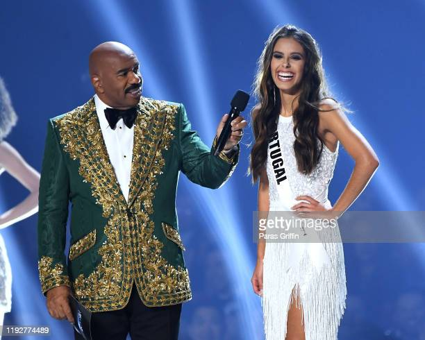 Steve Harvey interviews Miss Portugal Sylvie Silva onstage at the 2019 Miss Universe Pageant at Tyler Perry Studios on December 08 2019 in Atlanta...