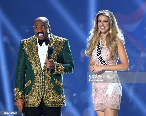 Steve Harvey interviews Miss Puerto Rico Madison Anderson onstage at the 2019 Miss Universe Pageant at Tyler Perry Studios on December 08 2019 in...