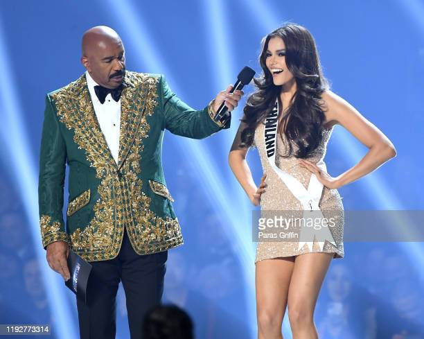 Steve Harvey interviews Miss Thailand Paweensuda Drouin onstage at the 2019 Miss Universe Pageant at Tyler Perry Studios on December 08, 2019 in...