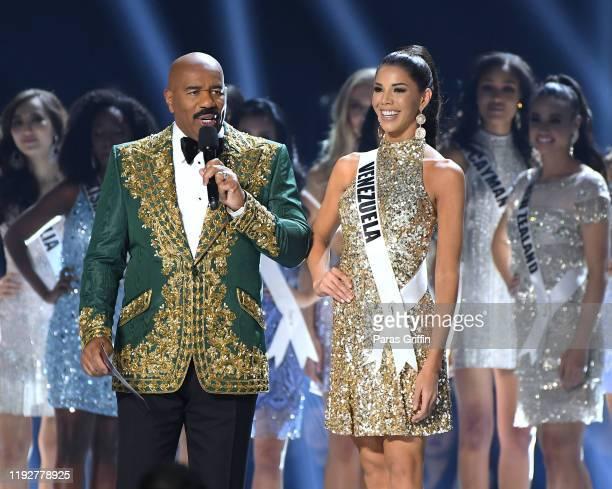 Steve Harvey interviews Miss Venezuela Thalia Olvino onstage at the 2019 Miss Universe Pageant at Tyler Perry Studios on December 08 2019 in Atlanta...