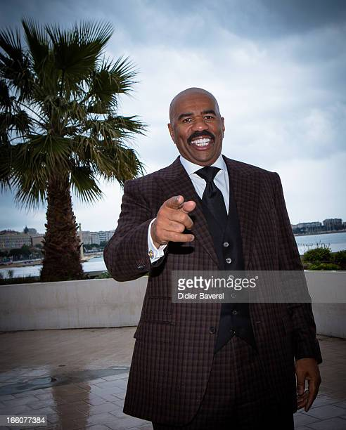 Steve Harvey poses during a photocall for the tv series'The Steve Harvey Show' at MIP TV 2013 on April 8 2013 in Cannes France
